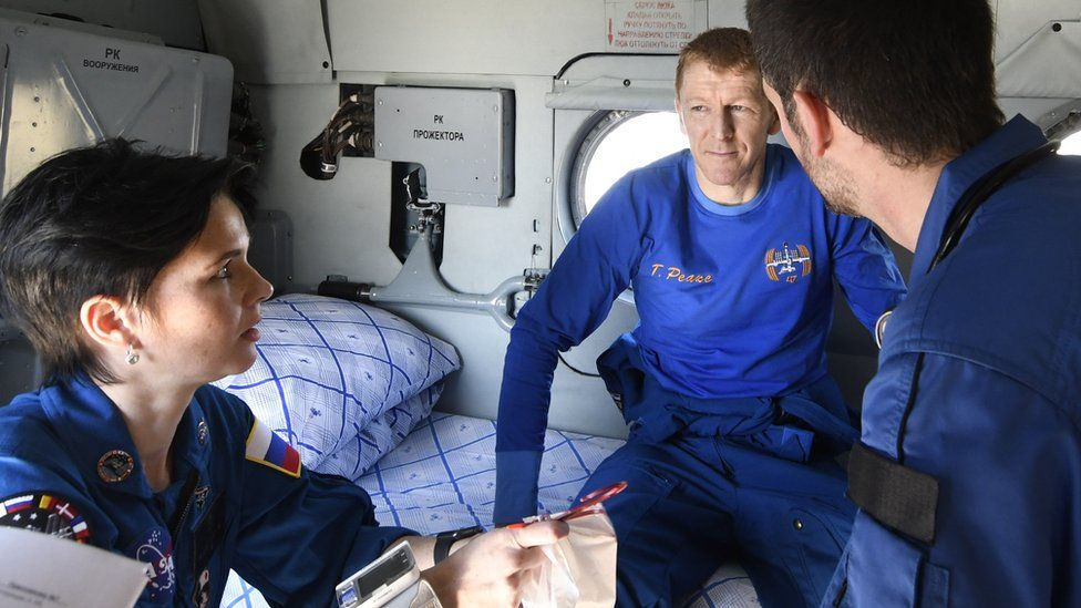 Tim Peake with recovery staff after landing