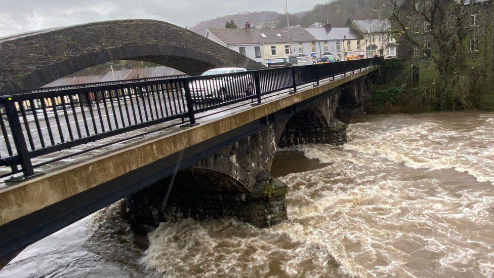 Car passes over river bridge at Pontypridd