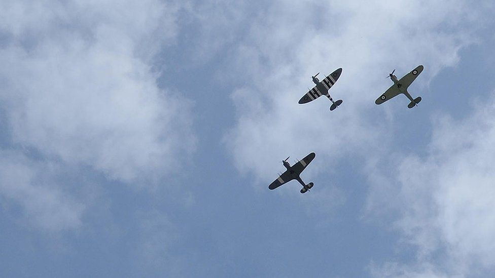 VE Day 70th anniversary celebrations. RAF's wartime fighter planes of the Battle of Britain Memorial Flight flying over Horse Guards, Whitehall, London