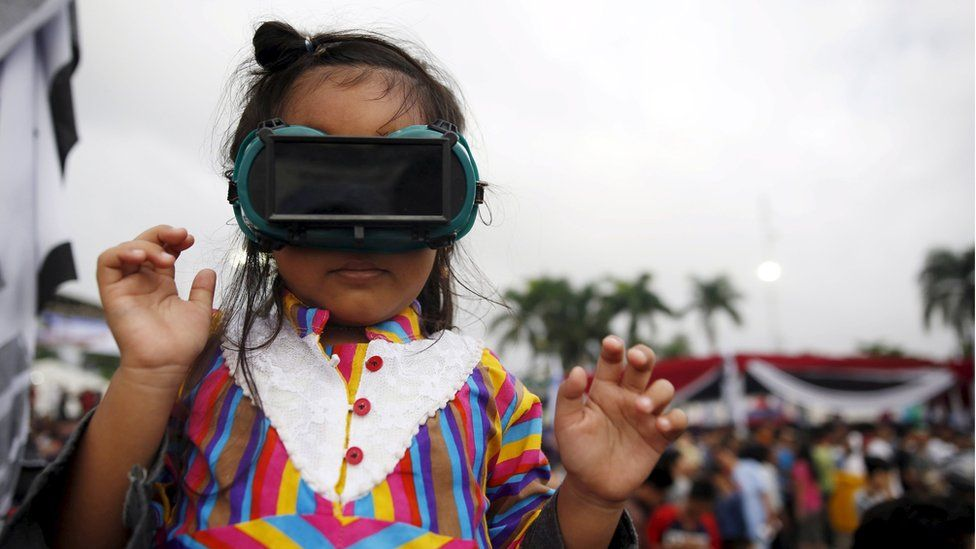 A child with special goggles on, in Indonesia