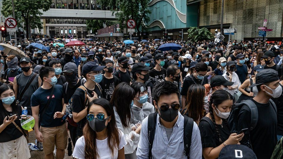 Protesters take part in an anti-government rally as they march on a street in Central district