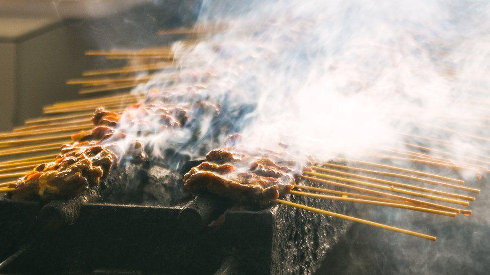 Meat being grilled on skewers