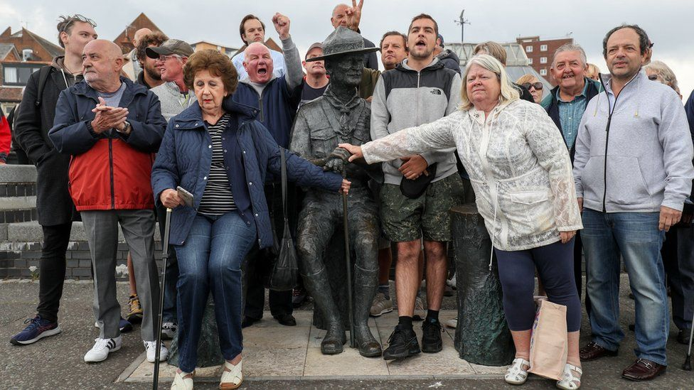 Local residents at statue