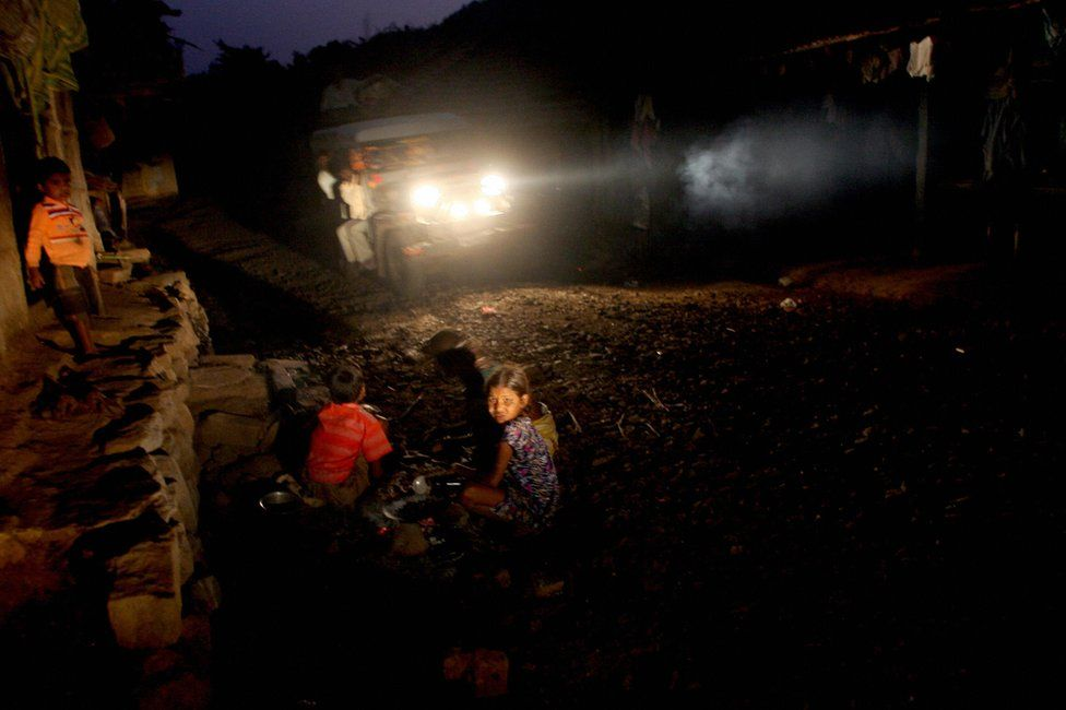 Indian children play outside their home in the tribal hamlet of Wada, in Thane on the outskirts of Mumbai on November 18 2007.
