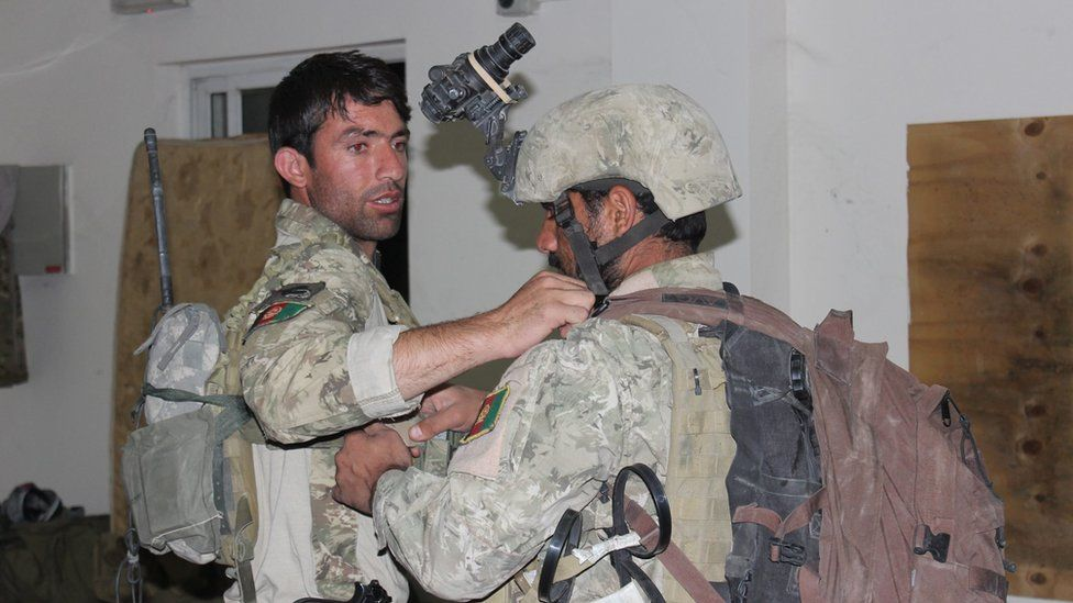 Afghan special forces checking their equipment as they prepare to launch a counter-offensive to regain control of Kunduz