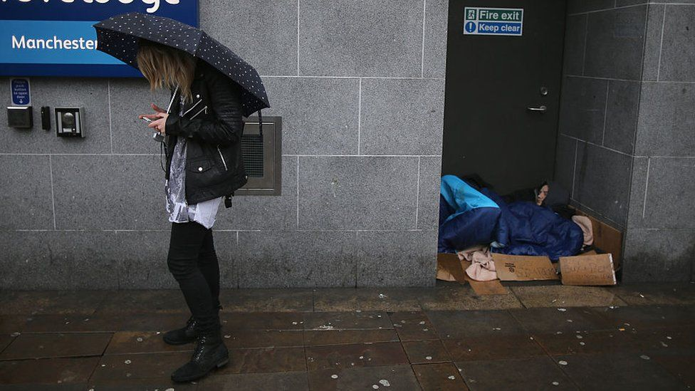 Homeless man sleeping in Manchester doorway