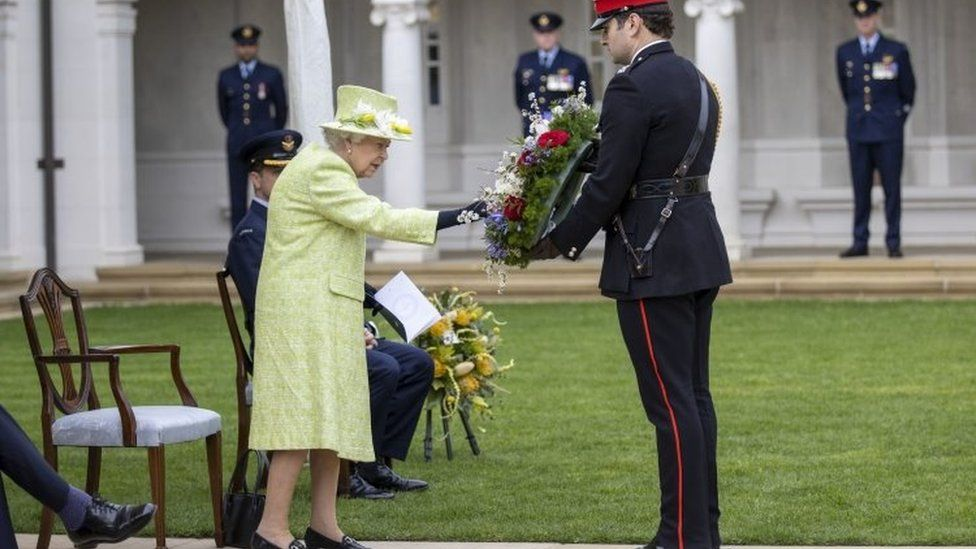 Queen Elizabeth II inspects a wreath during a service to mark the Centenary of the Royal Australian Air Force
