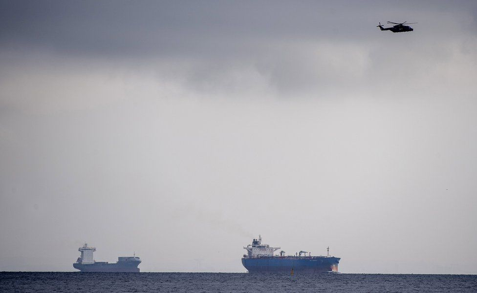 Helicopters search Copenhagen harbour for a missing submarine