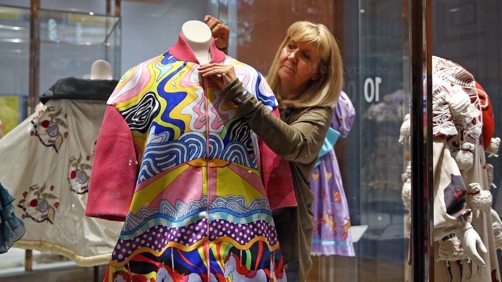 Curator Pauline Rushton with Grayson Perry dress
