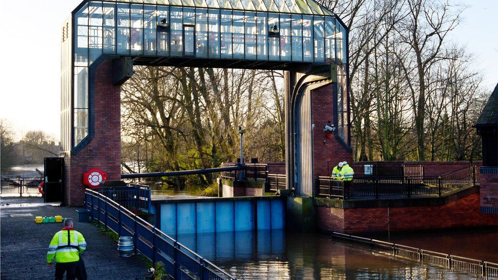 Work continues to the Foss Barrier after the adjoining pumping station became inundated with flood water, on 29 December 2015 in York, England