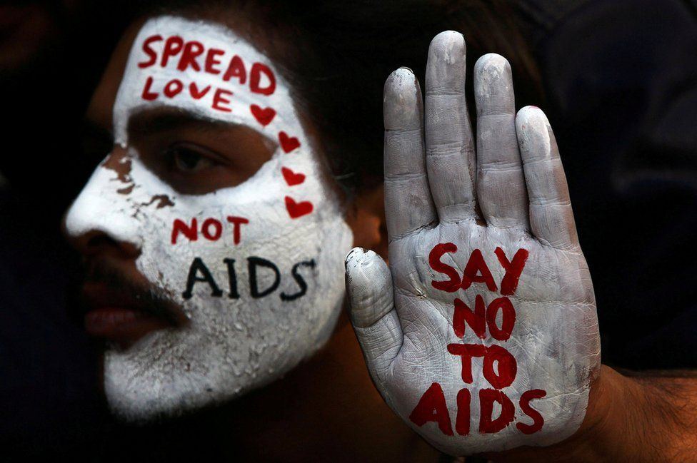 A student displays his face and hand painted with messages during an HIV/AIDS awareness campaign on World AIDS Day in Chandigarh, India, 1 December 2017.