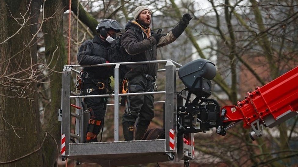 Protester on cherry picker