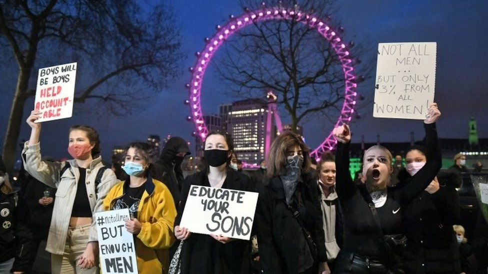 Demonstrators during a protest outside New Scotland Yard on Monday evening