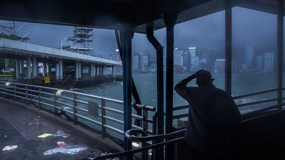 A man stands infront of Victoria Harbor on August 2, 2016 in Hong Kong, Hong Kong