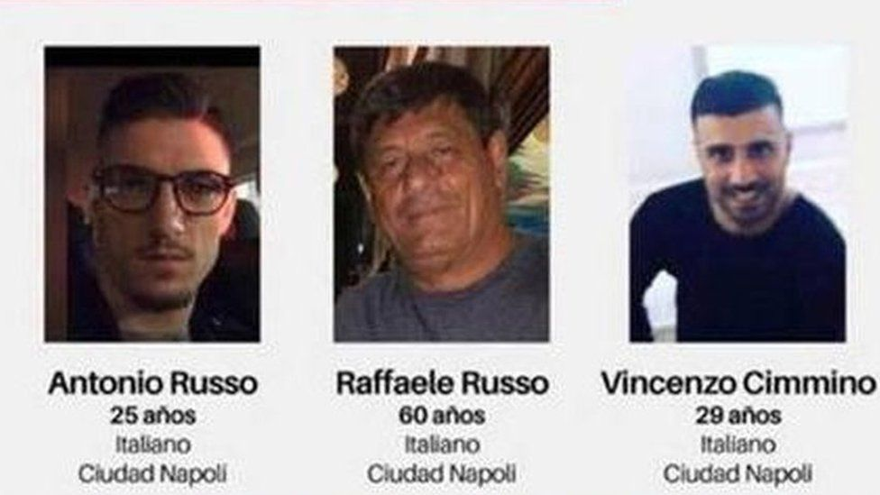 A missing poster shows the photos of the three Italians who disappeared in Mexico