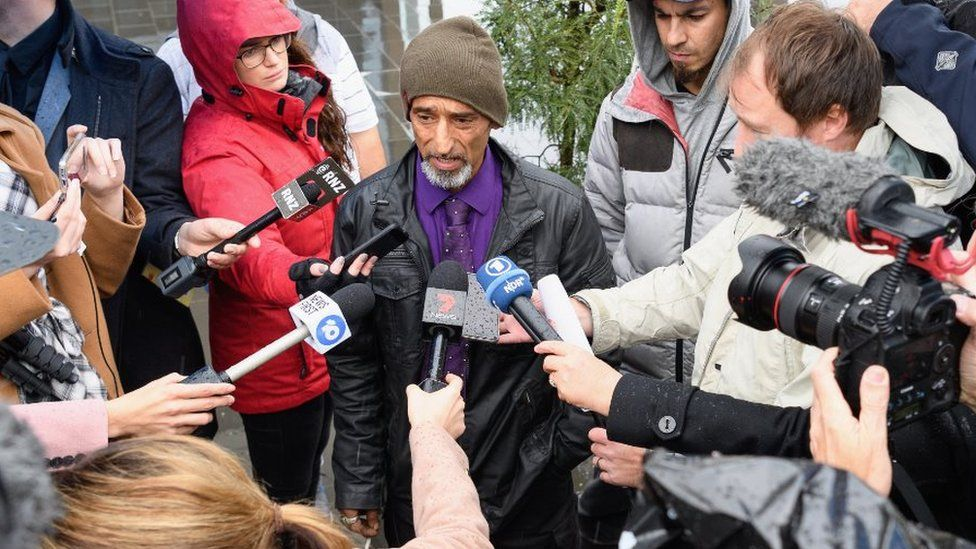 Omar Nabi speaking to reporters outside the Christchurch court
