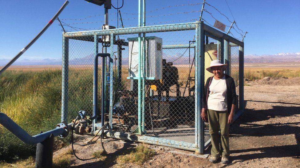 Sara Plaza next to a lithium miner's fresh water pump
