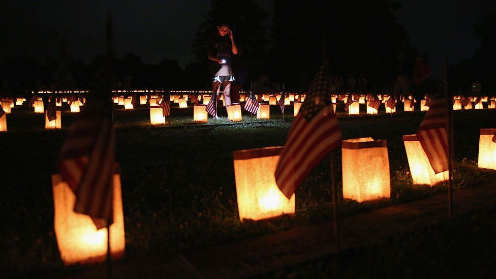 A girl looks over Civil War graves at the Soldiers' National Cemetery on June 30, 2013 in Gettysburg, Pennsylvania. Hundreds of people gathered for the official ceremony marking the 150th anniversary of the Battle of Gettysburg.