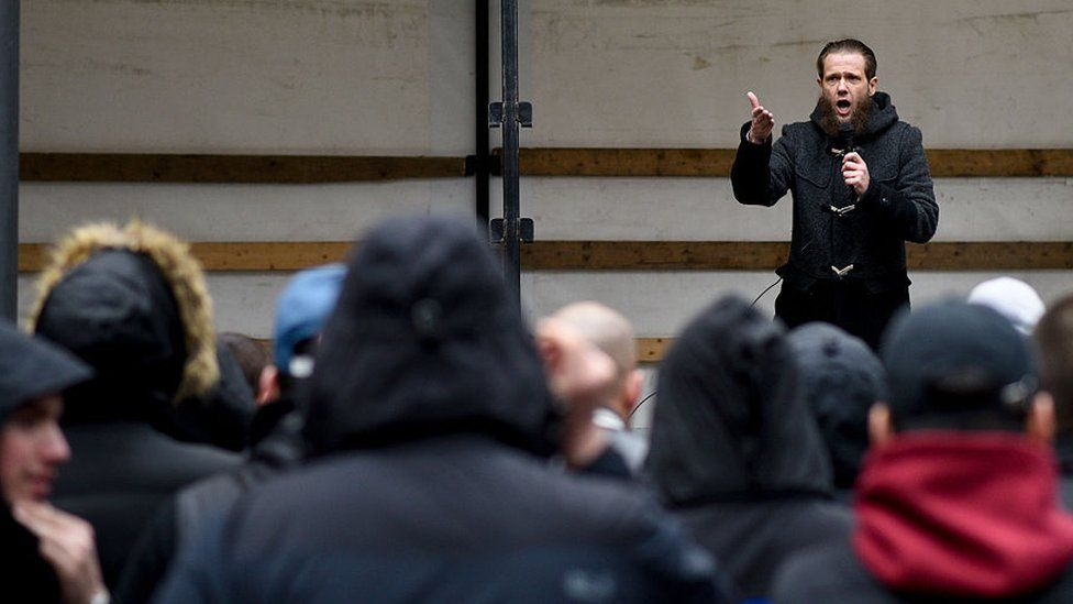 Radical Islamic convert Sven Lau speaks to Salafi supporters at a public gathering on 14 March 2015 in Wuppertal, Germany