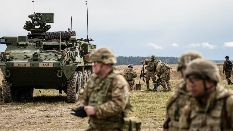 US soldiers are pictured prior the beginning of the official welcoming ceremony of Nato troops in Orzysz, Poland, on April 13, 2017