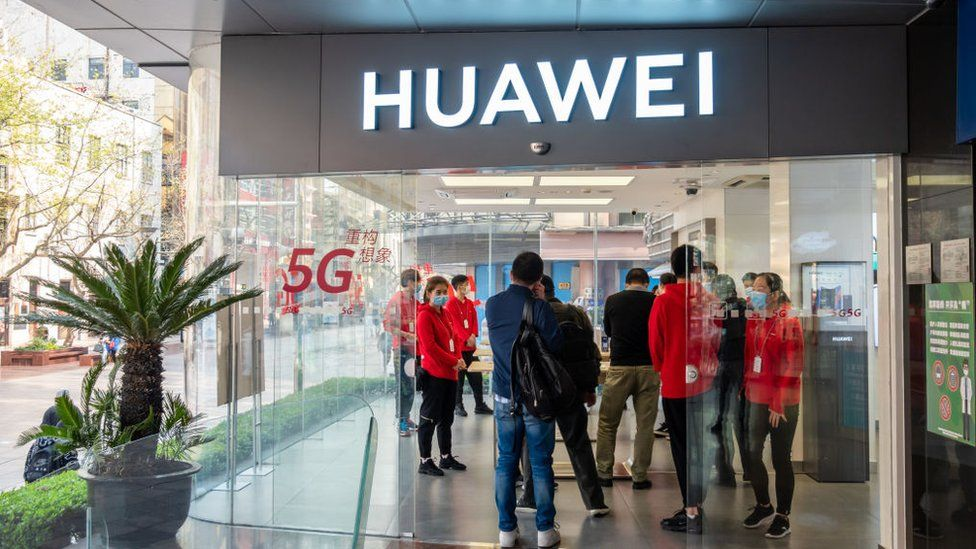 Customers at a Huawei shop in Shanghai