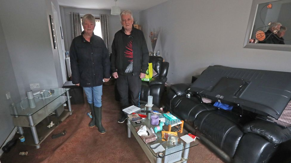 Jean Hendrie and William Craik cleaning their house in Pyothall Court in Broxburn, West Lothian after flooding.