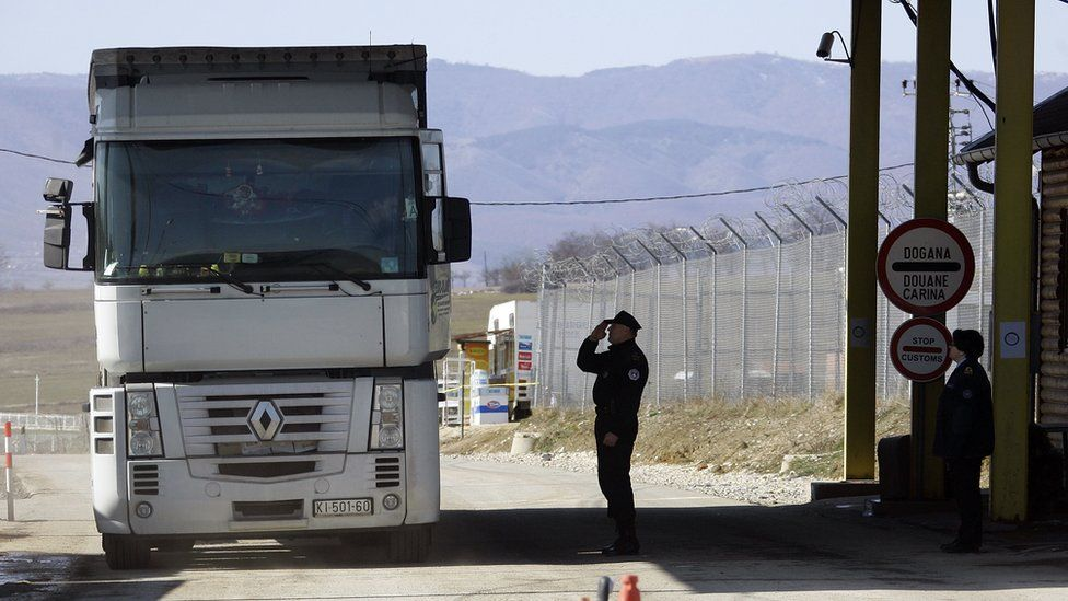A officer of the Kosovo border police checks a lorry leaving Kosovo at a checkpoint on the border with Serbia on February 19, 2008 in Merdar, Kosovo