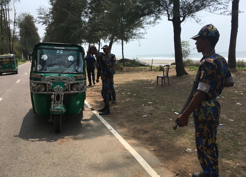 Officers stop rickshaws near Cox's Bazar