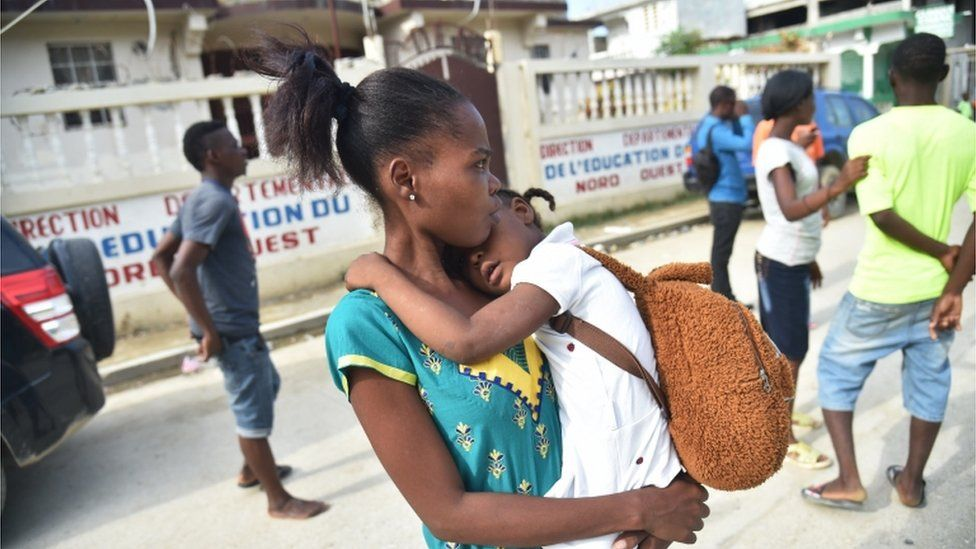 Haitians recover from an earthquake in 2018