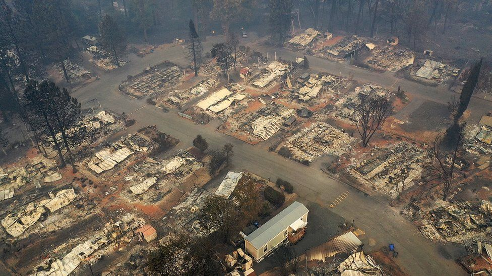 Trailer park is photographed in aerial shot as being totally destroyed