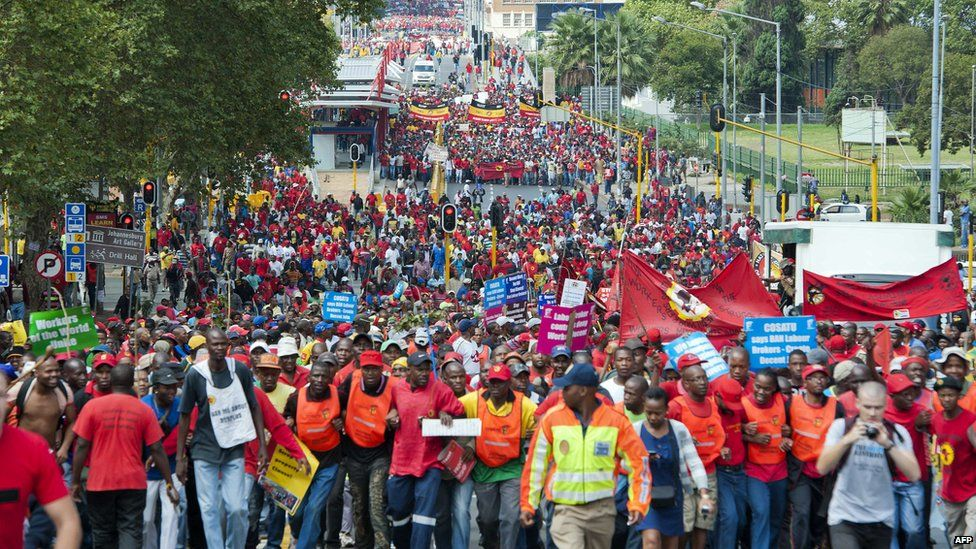 Thousands of protesters march through Johannesburg on March 7, 2012 to protest new tolls on highways between Johannesburg and nearby Pretoria and the practices of temp agencies, which unions say are hurting the poor.