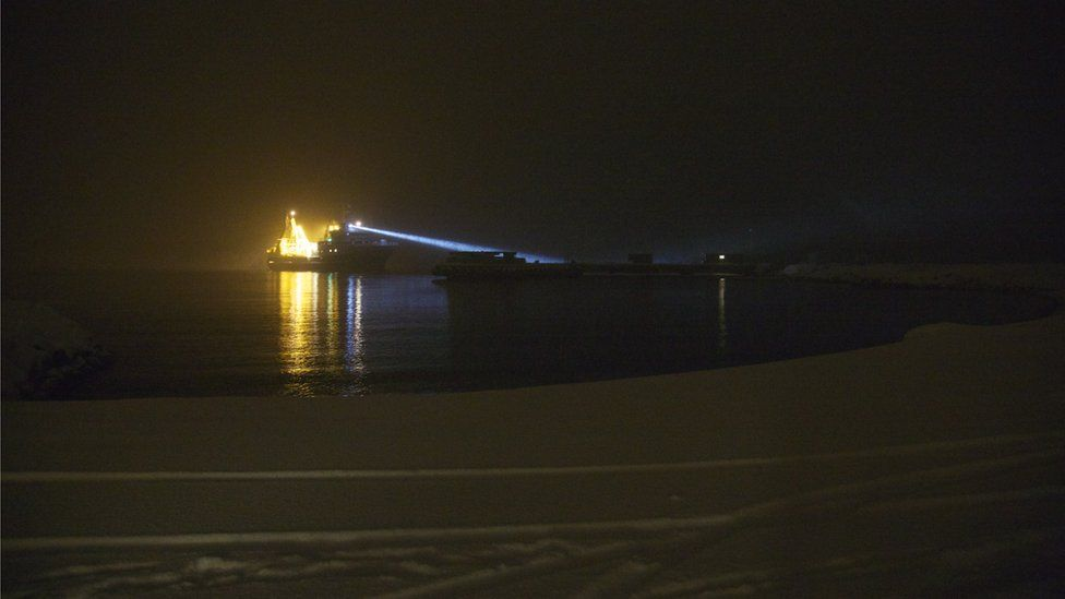 Research boat lit up in the darkness