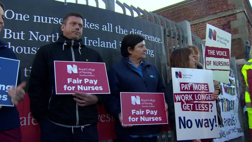 Members of the Royal College of Nursing outside the Royal Victoria Hospital on Tuesday