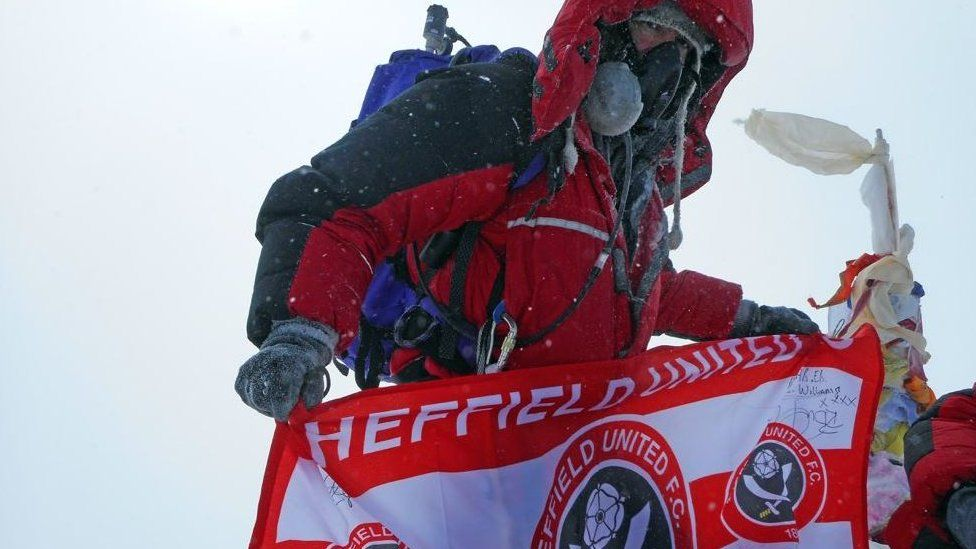 Ian Toothill with Sheffield United FC flag on Mount Everest