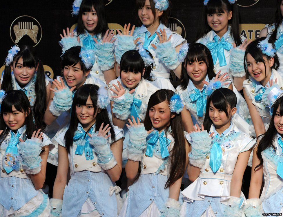 Japanese all girl band AKB-48 arrive at the 22nd Golden Melody Awards in Taipei on June 18, 2011