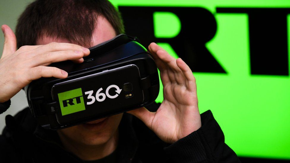 A man tries on a VR goggles at the stand of Russia's state-controlled broadcaster RT during the 10th Russian Internet Week in Moscow on November 1, 2017.