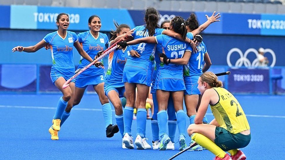 Players of India celebrate after defeating Australia 1-0 in their women's quarter-final match of the Tokyo 2020 Olympic Games field hockey competition.