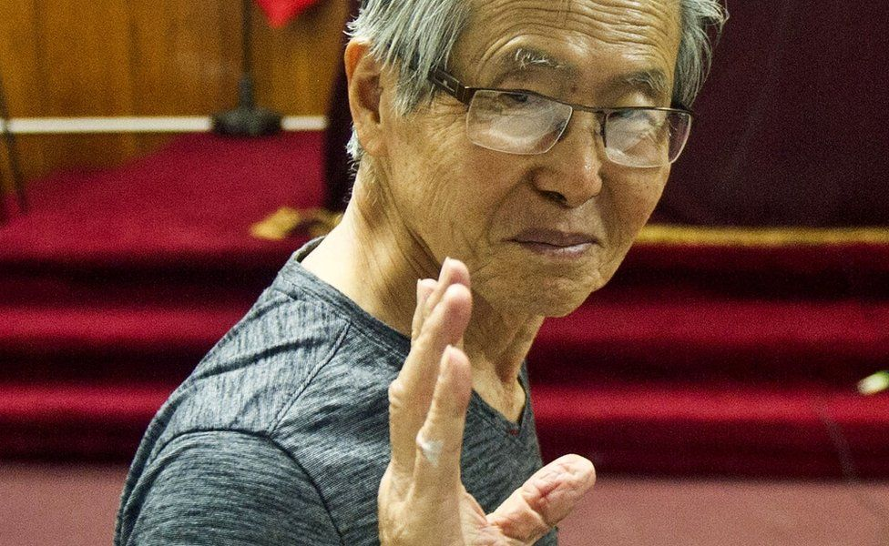 Peru's ex-President Alberto Fujimori gestures before the reading of the verdict on charges of embezzling state funds and using them to manipulate the media, at a police base in Lima, 8 January 2015