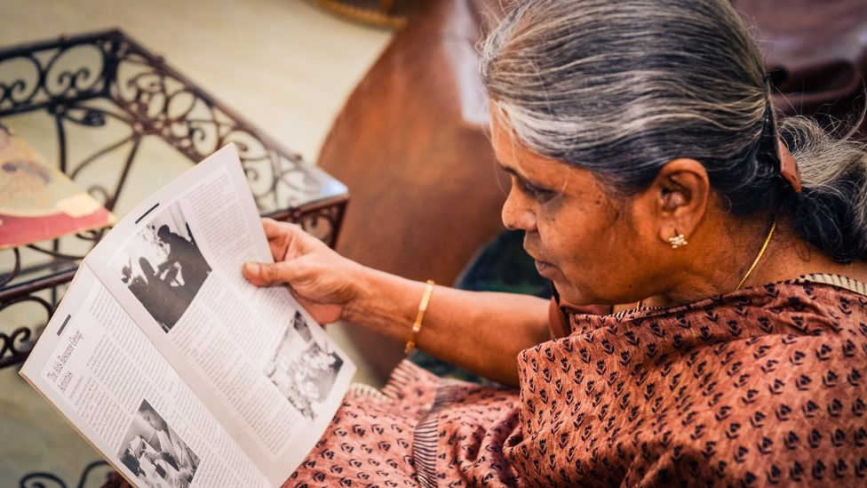 Nirmala reads some of her cuttings