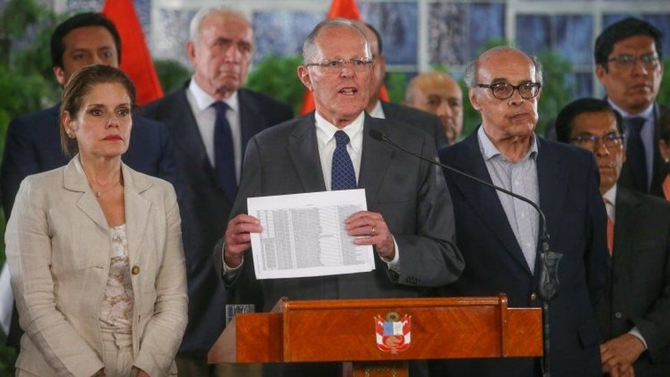 A handout picture distributed by the Peruvian Presidency shows President Pedro Pablo Kuczynski appearing in Lima on a televised message to the Nation on December 14, 2017