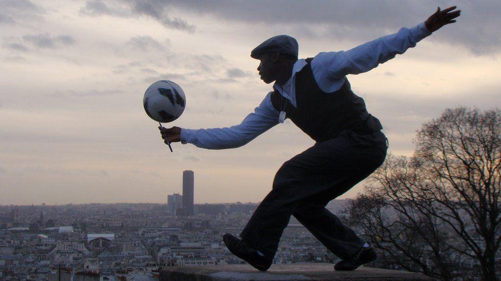 Man balancing a ball on a pencil