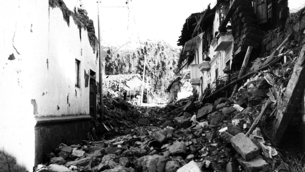 View of destroyed adobe houses in Huaraz