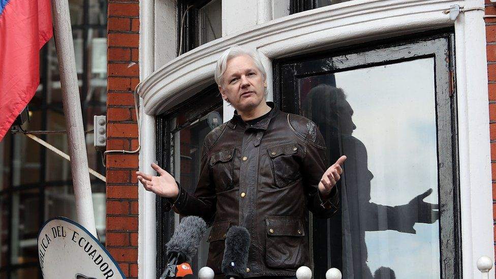 Julian Assange stands on the balcony of the Ecuadorian embassy in London.