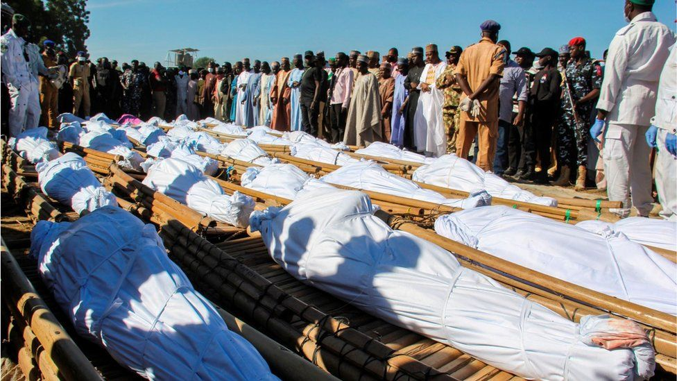 Mourners attend the funeral of 43 farm workers in Zabarmari, about 20km from Maiduguri, Nigeria, on November 29, 2020 after they were killed by Boko Haram fighters in rice fields near the village of Koshobe on November 28, 2020.