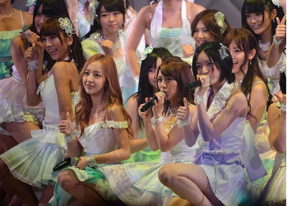 Members of girl band AKB48 perform on stage during an event to select which of them will get to perform the band's 27th song, in Tokyo on 6 June 2012.
