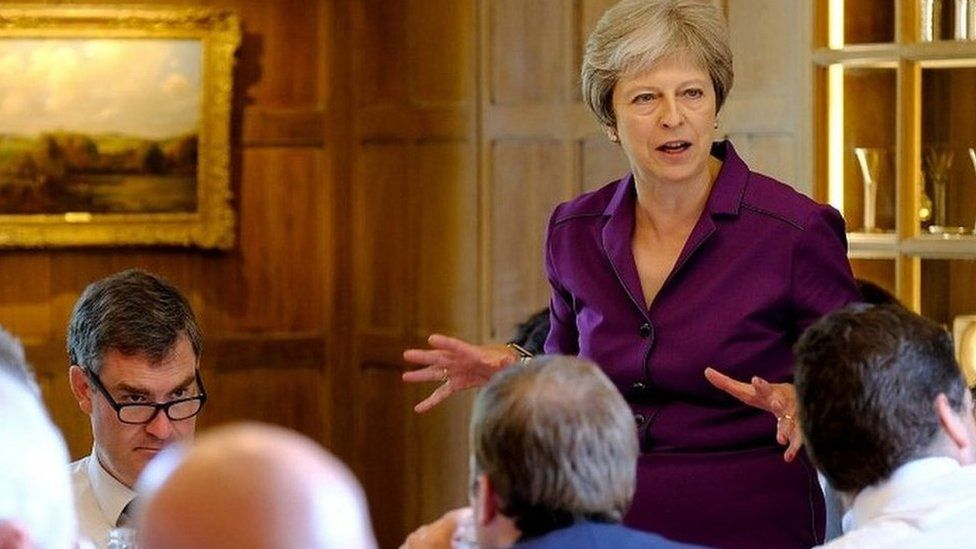Theresa May addressing ministers at Chequers