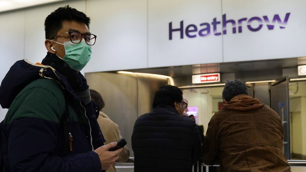 Photo from 22 January of a passenger wearing a mask when arriving at Terminal 4 of Heathrow Airport, London