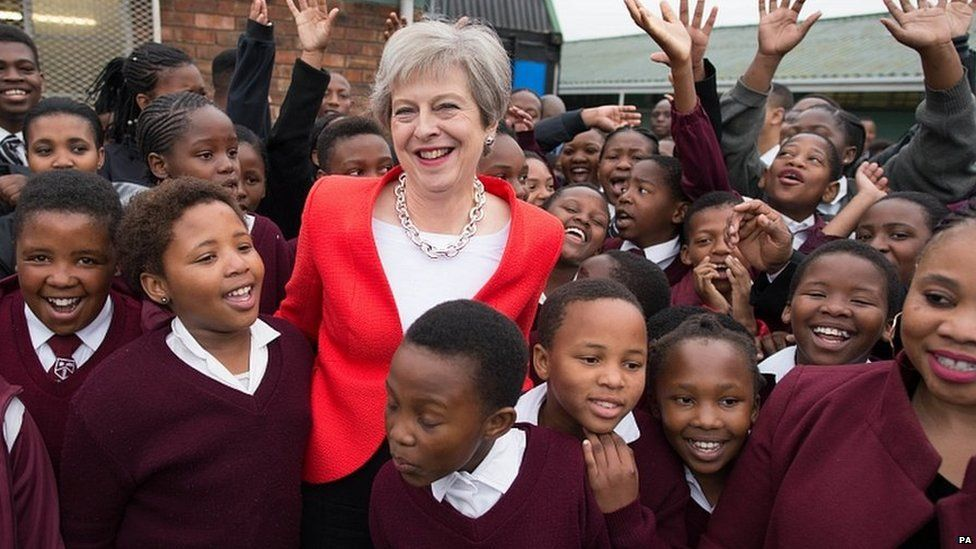Theresa May meets students and staff at I.D. Mkize Secondary School in Cape Town, which is twinned with Whitby High School in Yorkshire