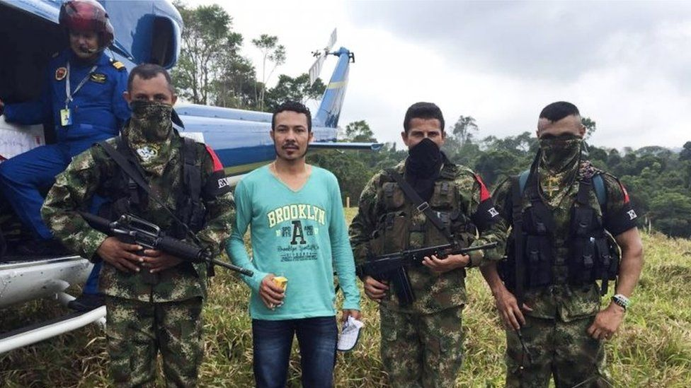 Handout picture released by Cali's' Archbishopric showing Colombian Army corporal Jair de Jesus Villar Ortiz escorted by ELN guerrillas in a rural area between the departments of Antioquia and Bolivar, Colombia on March 20, 2016.