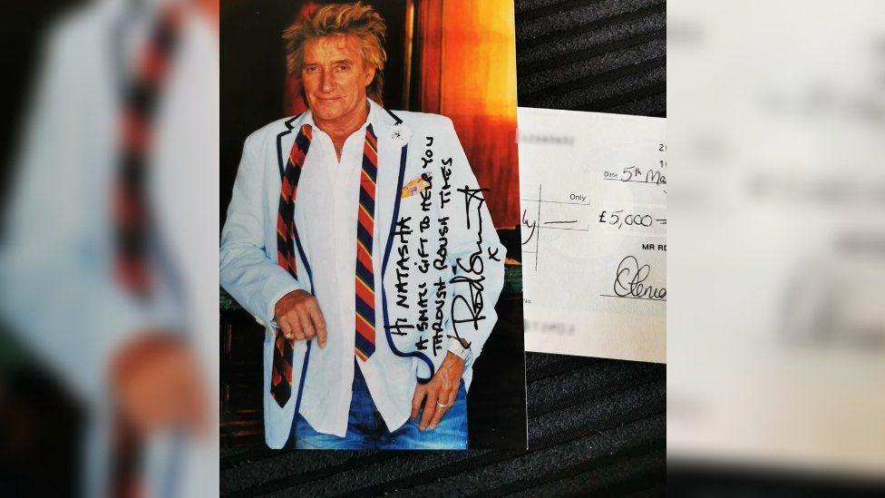 Rod Stewart and cheque